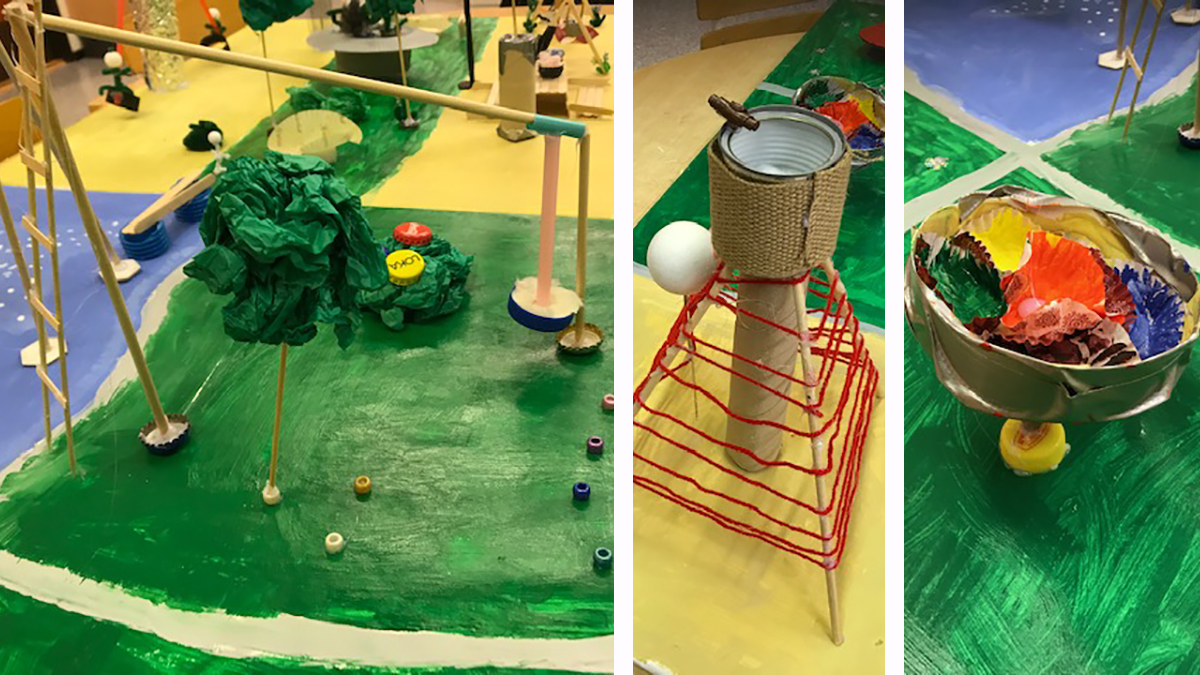 En bild på barnens modell av lekplatsen, i papper, kartong, snören, konservburkar med mera.